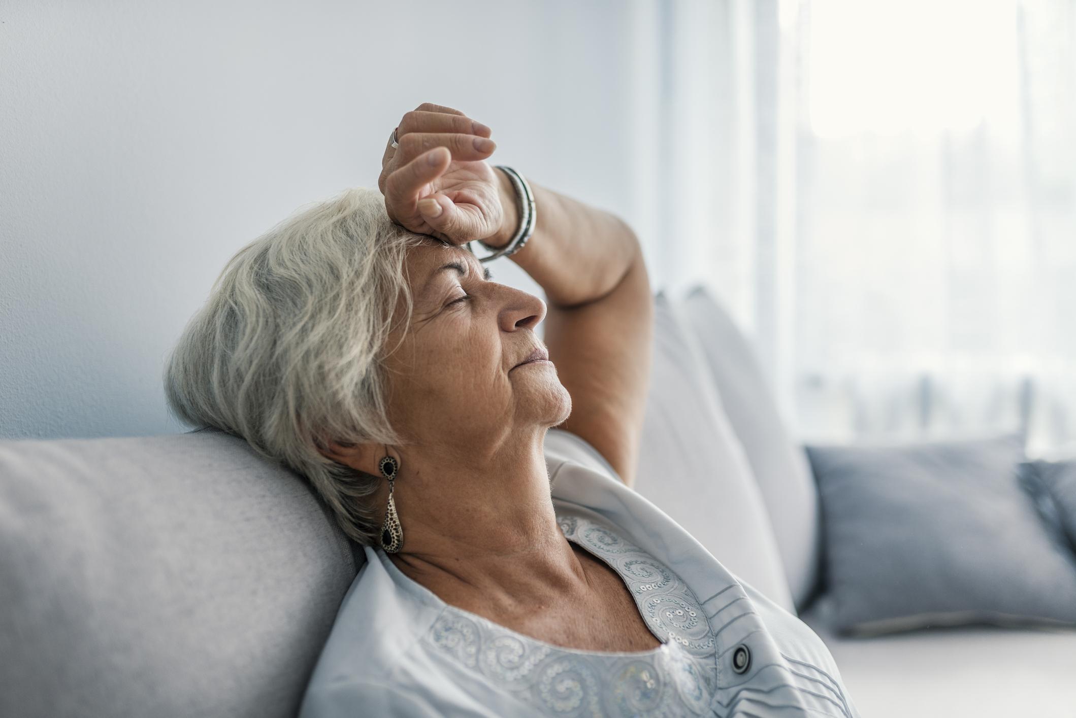 Senior woman experiences fatigue.